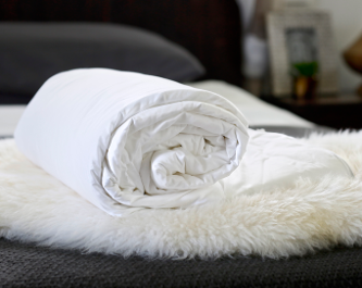 Cot size long-strand mulberry silk-filled duvets from Silk Bedding Direct
