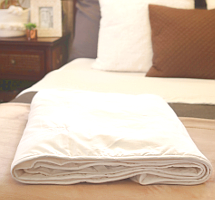 Long-fibre mulberry silk-filled mattress pad from Silk Bedding Direct