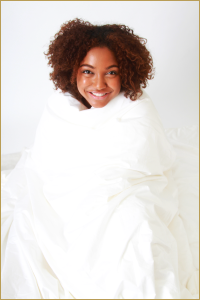 Silk duvet wrapped around a young woman