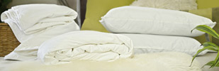 Silk duvets, hand sewn and finished to perfection
